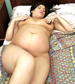 Loli is a horny pregnant hottie with an enormous belly and she loves to show it off live